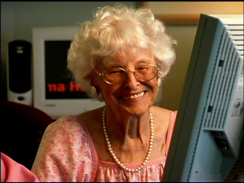 panning over seniors using computer - silver surfer stock videos & royalty-free footage