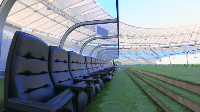 panning passed dugout in empty maracana stadium - bench stock videos & royalty-free footage