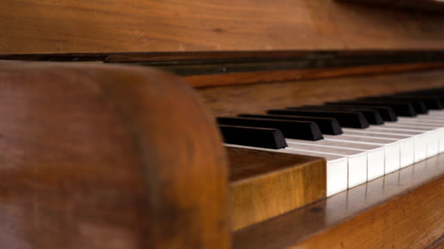 panning: Piano keyboard of an old music instrument