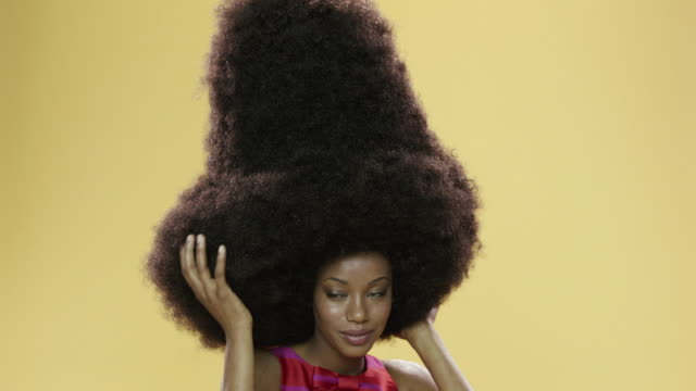 panning portrait of beautiful young woman with large afro - dress stock videos & royalty-free footage