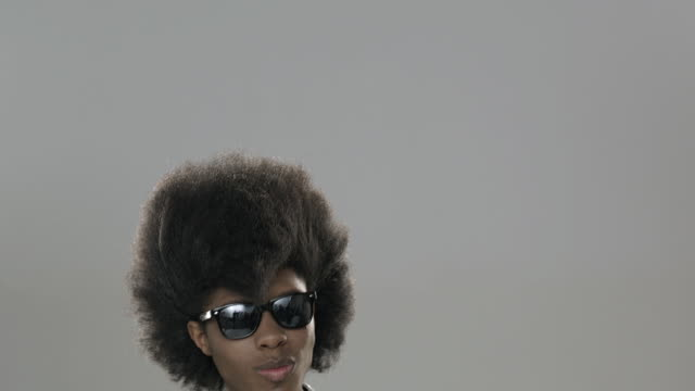 panning portrait of young man with styled big hair - big hair stock videos and b-roll footage