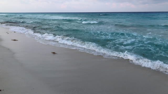 Panning right to left sea to beach and hotel zone horizon