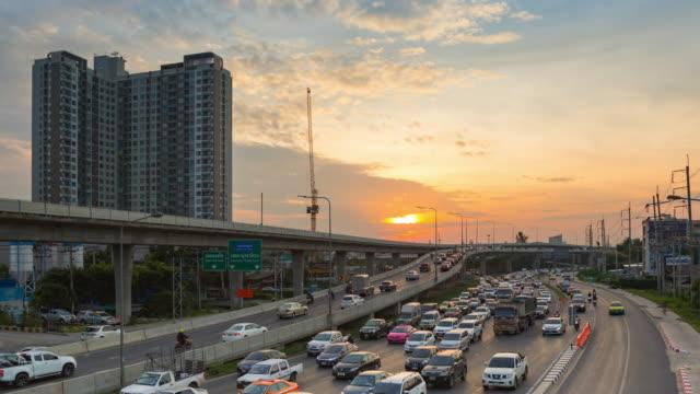 panning shoot : 4k time-lapse traffic bangkok at dusk - non urban scene stock videos & royalty-free footage