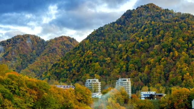 panning shoot:4k time-lapse jozankei onsen town skyline in autumn, hokkaido, japan - bathhouse stock videos & royalty-free footage