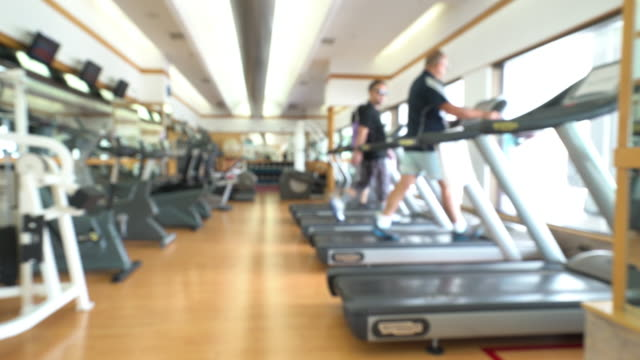 Panning shot: Abstract blurred background: fitness center gym club