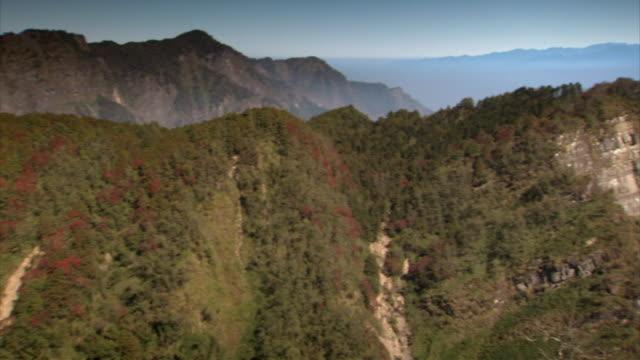 panning shot across a mountain range in taiwan. - taiwan stock videos & royalty-free footage