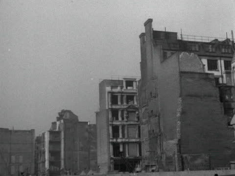 panning shot across bombed buildings to the metal framework of a new building with st paul's cathedral in the background 1951 - st. paul's cathedral london stock videos & royalty-free footage