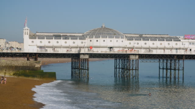 panning shot across brighton's palace pier. - blue dog stock videos & royalty-free footage