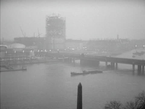 panning shot across the river thames to the royal festival hall. 1960. - royal festival hall stock videos & royalty-free footage