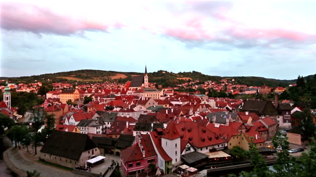 panning shot: Aerial  Cesky Krumlov old Town at dusk Czech Republic