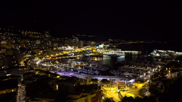 panning shot aerial monaco monte carlo harbour french riviera night - monte carlo stock videos & royalty-free footage