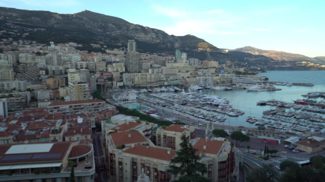 panning shot aerial monaco monte carlo harbour french riviera sunset - monaco stock videos and b-roll footage