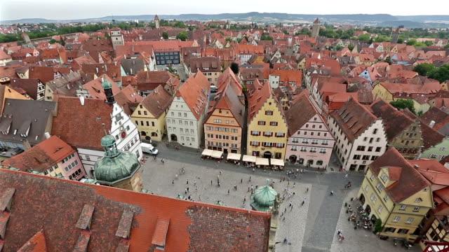 panning shot: aerial pedestrian crowded rothenburg ob der tauber bavaria, germany - film festival stock videos & royalty-free footage