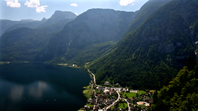 panning shot: aerial view of Hallstatt village and lake, Austria