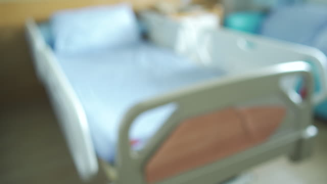 panning shot blurred empty bed on hospital ward - domestic room stock videos & royalty-free footage