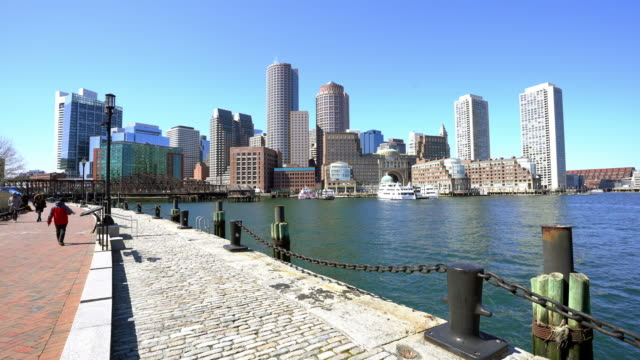 panning shot boston cityscape skyline building with boston bay from fan pier park ma usa - bay of water stock videos & royalty-free footage