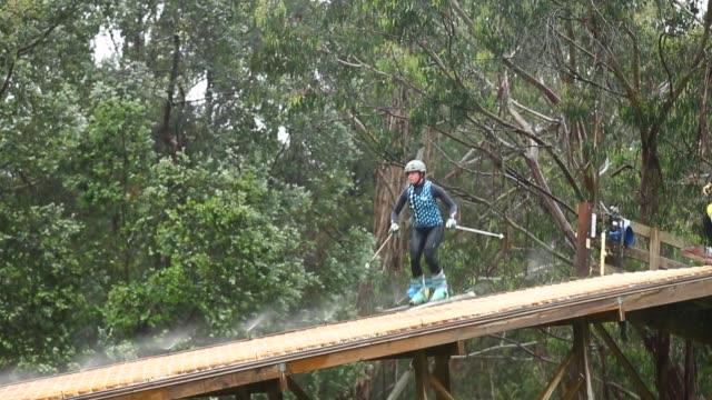 Panning Shot Britt Cox heads down the ramp to jump 131113