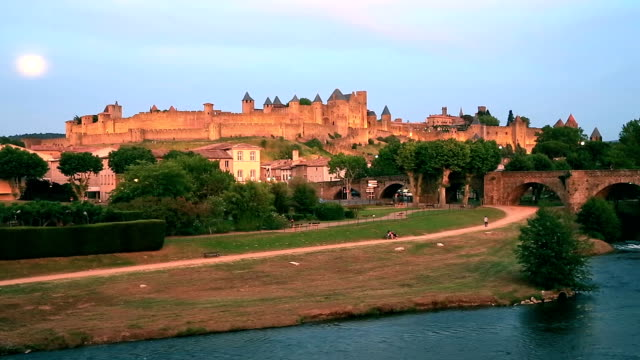 hd panning shot: carcassonne cityscape france at dusk - carcassonne stock videos & royalty-free footage