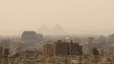 panning shot cityscape of cairo in egypt - egypt stock videos & royalty-free footage