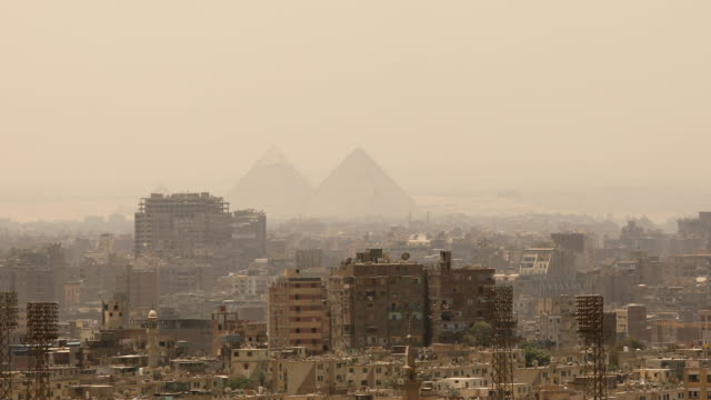 panning shot cityscape of cairo in egypt - revolution stock videos & royalty-free footage