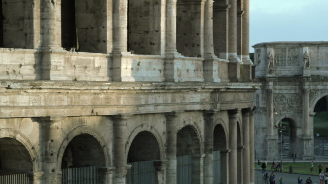 panning shot close up of colosseum to arch of constantine - arch of constantine stock videos and b-roll footage