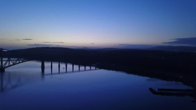 panning shot forth bridge at dawn - romantic sky stock videos & royalty-free footage