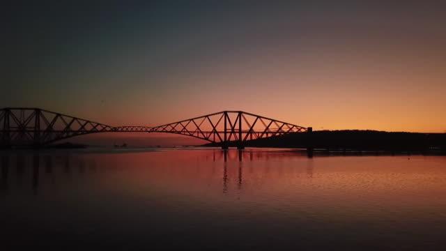 panning shot forth bridge at sunrise - romantic sky stock videos & royalty-free footage