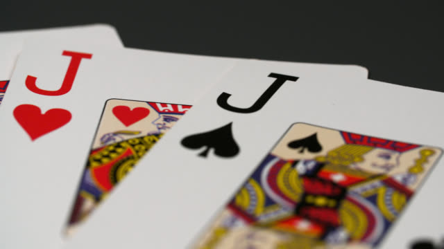panning shot four of a kind playing cards - four objects stock videos & royalty-free footage