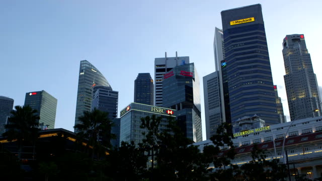 a panning shot from business district skyline to merlion - merlion fictional character stock videos and b-roll footage