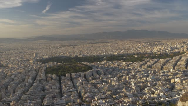 panning shot from summit of mount lycabettus of restaurant and athens, athens, greece, europe - lycabettus hill stock videos & royalty-free footage