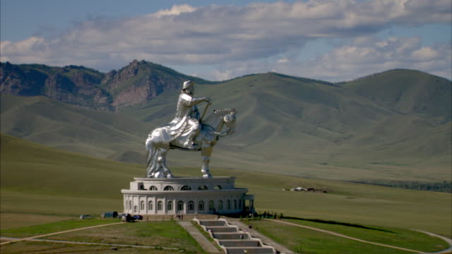 Panning shot from the Genghis Khan Equestrian Statue to the surrounding Mongolian countryside.