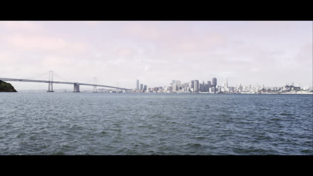 panning shot from the golden gate bridge to san francisco. - san francisco bay stock videos and b-roll footage