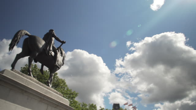 Panning shot from the statue of George IV towards Nelson's Column.
