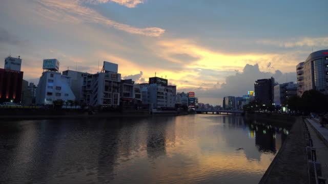 panning shot: fukuoka old town along naka river at nakasukawabata sunset twilight japan. - fukuoka prefecture stock videos & royalty-free footage