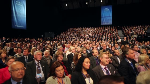 panning shot general view of delegates taking part in the 2013 annual conservative party conference in manchester the five day conference had keynote... - preacher stock videos & royalty-free footage