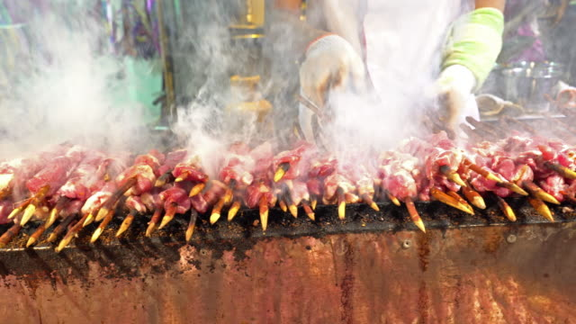 panning shot: goat and lamb meat bbq in chinese style in xian china - meat stock videos & royalty-free footage