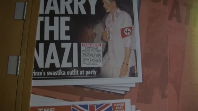 Panning Shot 'Harry The Nazi' cover from 'The Sun' Empty News Of The World offices in Wapping London on August 12 2013
