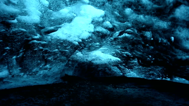 hd panning shot: ice cave at vatnajokull glacier jokulsaron iceland - cave stock videos and b-roll footage