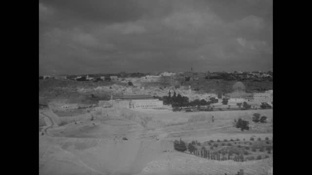 stockvideo's en b-roll-footage met panning shot jerusalem from mount of olives; 1956 - breedbeeldformaat