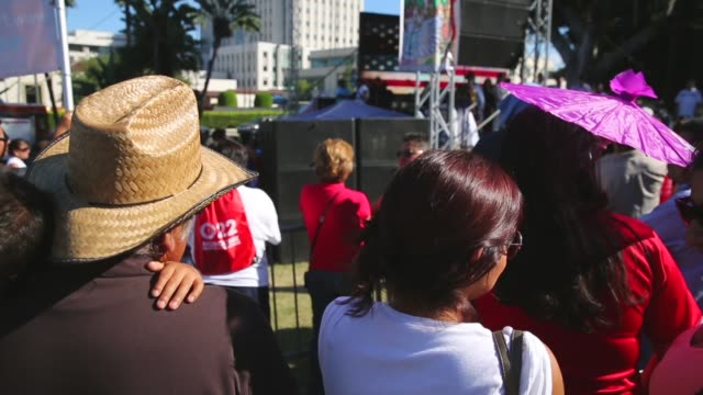 """panning shot, latinos listen to a rendition of the american national anthem to inaugurate the sixth annual """"feria de los moles,"""" or mole fair, billed... - mexican american stock videos & royalty-free footage"""