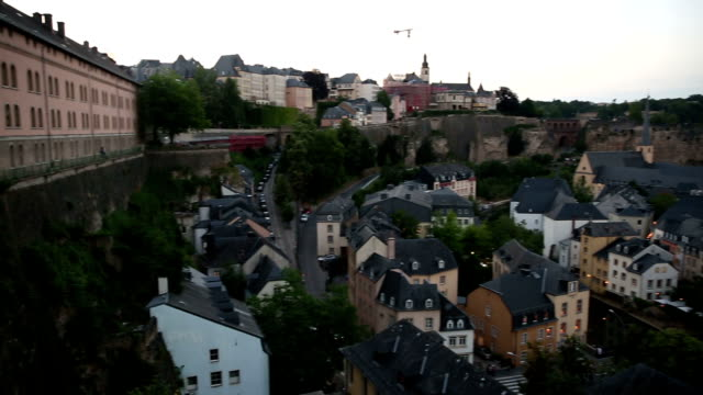 panning shot: luxembourg city old town cityscape at dusk - luxembourg benelux stock videos & royalty-free footage