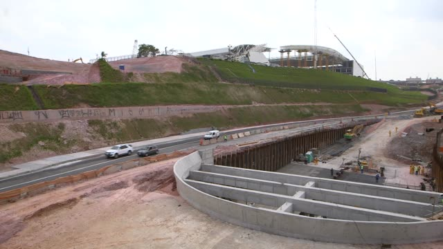 stockvideo's en b-roll-footage met panning shot motorway stadium link under construction a tragic accident at arena de sao paulo led to the death of two workers when the roof collapsed... - schakel