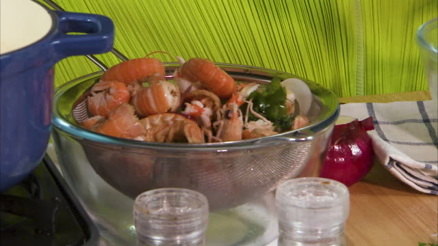 panning shot of a bowl of prawns to whisking - hollandaise sauce stock videos and b-roll footage