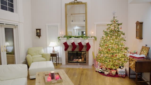 Panning shot of a living room at Christmas