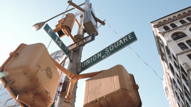 panning shot of a union square street sign in new york city - union square new york city stock videos and b-roll footage