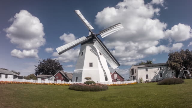 panning shot of a windmill with clouds behind - mill stock videos & royalty-free footage