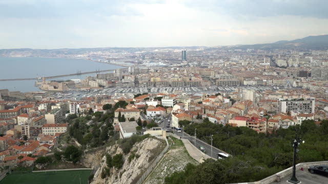 panning shot of aerial marseille city with old vieux port - notre dame de la garde marseille stock videos and b-roll footage