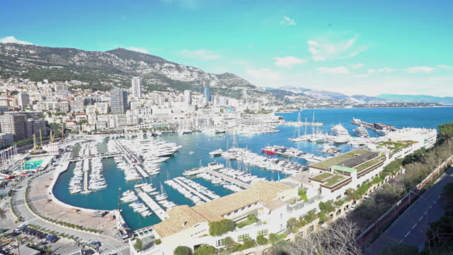 panning shot of aerial monaco monte carlo harbour french riviera - monaco stock videos and b-roll footage