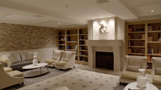 panning shot of an elegant lounge - ロビー点の映像素材/bロール