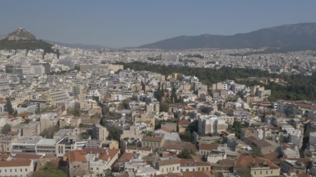 panning shot of athens toward mount lycabettus from the acropolis, athens, greece, europe - lycabettus hill stock videos & royalty-free footage